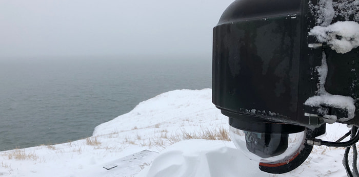 XClear self-cleaning camera enclosure system installed on Round Island in Alaska.